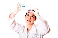 Female scientist looking at tissue culture flask