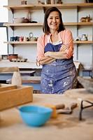 Portrait of woman in pottery workshop