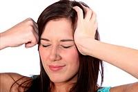 Beautiful Brunette Woman with Headache