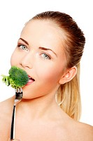 Woman eating green broccoli