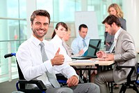Disabled businessman smiling in office
