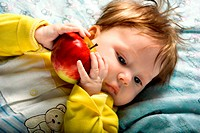 Beautiful baby with ripe red apple