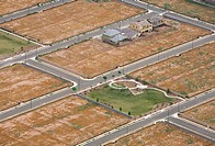 Aerial views of unfinished and abandoned housing developments in the Phoenix, Arizona area.