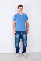 portrait of happy young casual man isolated on white bacground