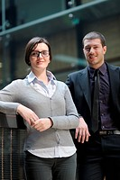 Young smiling business woman and business man portrait