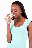 Young woman looking into her glass of water
