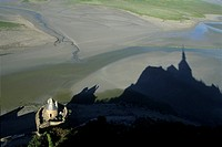 shadow of the monastery on the shore at low tide, Mont-Saint-Michel bay, Manche department, Normandy region, France, Europe