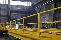 hard iron and steel industri worker working indoor in factory with weld machine