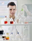 young man scientist in chemistry bright lab