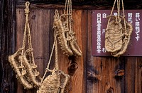 ZORI SANDALS hang on the wall of a RYOKAN in the MOUNTAIN VILLAGE of OGAMACHI, JAPAN