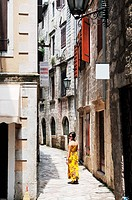 tourist woman walk trought old streets
