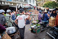 Myanmar, Burma  Mandalay Market Street Traffic  Street Food Vendor Carrying his Kit