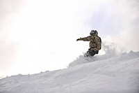 freestyle snowboarder jump and ride free style at sunny winter day on mountain