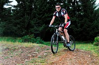 healthy lifestyle and fitness concept with mount bike man who ride bike outdoor