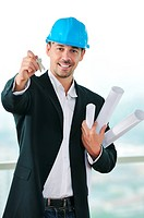 young business man isolated on white holding new home keys and representing sucess in real estate industry