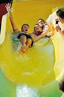 young boys gruop have fun together on outdoor swimming pool at aquapark
