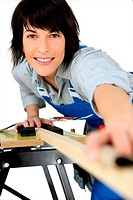 Female carpenter using workbench