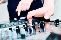 dj equipment gramophone and mixete with dj hand on party event