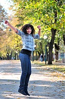 brunette Cute young woman dancing outdoors in nature