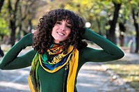 brunette Cute young woman with colorful scarf smiling outdoors in nature