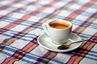 Cup of coffee on a colorful tablecloth