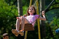 happy girl swinging NIKON D80, 10.6.2007, 1/800 at f/6.3, ISO 400, white balance: Auto, focal length: 320 mm