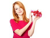 Red_haired girl in dress with present box
