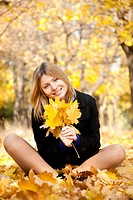 Smiling happy girl in autumn park