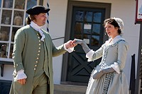 Two period actors reenact daily life in Colonial Williamsburg, Virginia.