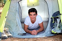 Teenager in a tent