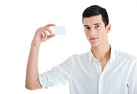 portrait of young businessman with empty business card isolated on white background