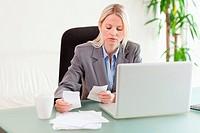 Businesswoman comparing bills