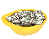 Yellow helmet full of dollars