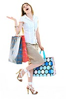 happy young adult women shopping with colored bags isolated over white background in studio