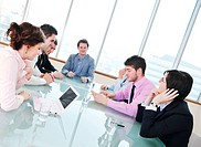 young business people group have meeting at conference room and have discusion about new ideas plans and problems