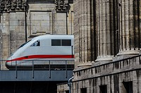 High-speed train passes between old buildings, Berlin, Germany