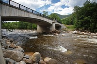 The Route 112 bridge, which crosses the the East Branch of the Pemigewasset River, in Lincoln, New Hampshire USA after Tropical Storm Irene in 2011  T...