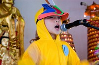 A boy singing on stage at Kindagarden Karaoke Competition