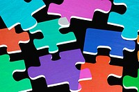 Jigsaw Puzzle Pieces on Black Background