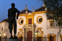 La Maestranza bullring and statue of bullfigther Pepe Luis Vazquez, Seville, Region of Andalusia, Spain, Europe