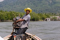 The chief of the village of Laem Naew captains a long boat _ THAILAND