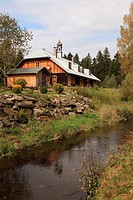 restored old wooden house built in typical Bohemian style near the Czech border at the foothills of the mountain Great Arber at Bayerisch Eisenstein, ...