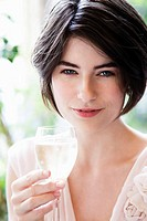 Woman drinking glass of wine outdoors