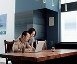 Japanese couple man using laptop at table