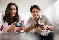 Mixed race couple playing video game