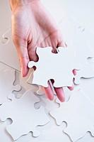 Cape Verdean woman holding puzzle piece