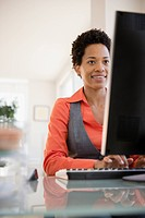 African American businesswoman typing on computer