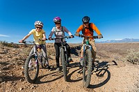 Family sitting on mountain bikes