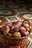 Various types of potato in a wicker basket