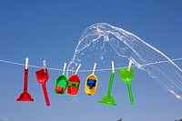 toys hanging on clothes line